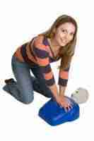 Young Woman Performing CPR
